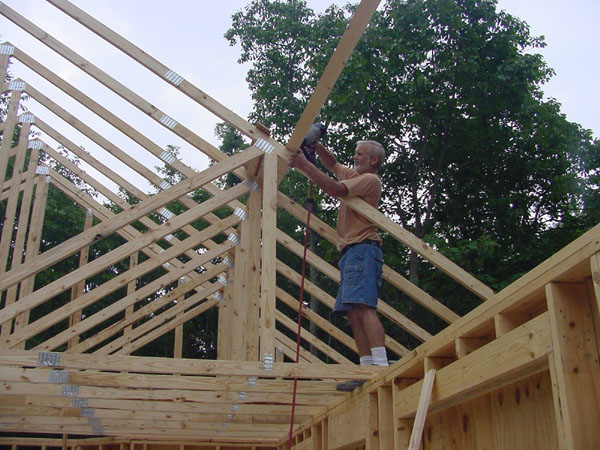 Installing The Roof Trusses And Sheathing
